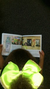 Every child received a copy! This little girl is enjoying Zoe Greene already!