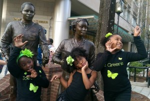 Zoe Greene Girlz strike a pose with History- The Sterling Students Statue in Greenville, SC